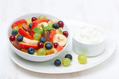 Fresh fruit and berry salad and cream Stock Image
