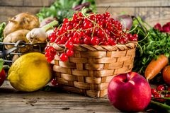 Fresh fruit, berry and vegetables. Fresh summer fruit, berry and vegetables on wooden rustic background copy space Stock Photography