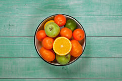 Fresh fruit in a bowl on a light wooden background Stock Photo