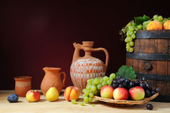Fresh fruit, ceramic dishes Stock Photography