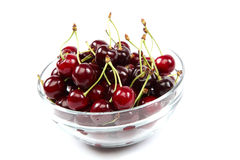 Fresh fruit cherries in a bowl glass. Royalty Free Stock Image