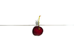 Fresh Fruit. Cherry falling into clear water Stock Photo