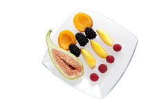 Fresh fruit close up. Mixed fresh fruit on a glass plate Royalty Free Stock Image