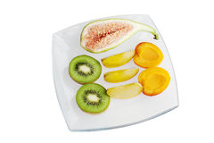 Fresh fruit close up. Mixed fresh fruit on a glass plate Royalty Free Stock Photos