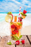 Fresh fruit Cocktail at the beach Stock Photo