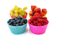Fresh fruit in colorful cups Royalty Free Stock Photo