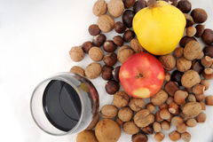 Fresh fruit combined with nuts and glass of wine royalty free stock photography