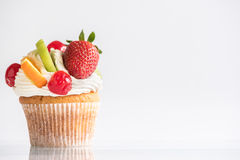 Fresh fruit and cream on cup cake Stock Image