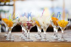 Fresh fruit cuts in champagne glasses Royalty Free Stock Images