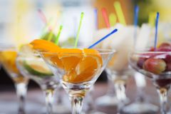 Fresh fruit cuts in champagne glasses Royalty Free Stock Photography