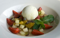 Fresh fruit desert with sorbet on white plate. Moscow, Russia Royalty Free Stock Photo