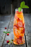 Fresh fruit detox water in bottle on wooden table Royalty Free Stock Photos
