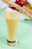 Fresh fruit drink. A glass full of a healthy fresh fruit drink made from apples and ginger Stock Image
