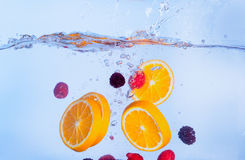 Fresh Fruit Falls under Water with a Splash Royalty Free Stock Photo