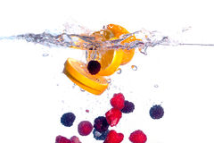 Fresh Fruit Falls Under Water With A Splash Stock Photography