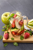 Fresh fruit Flavored infused water mix of apple, strawberry and Royalty Free Stock Photography