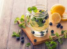 Fresh fruit Flavored infused water mix of blueberry, lemon and m. Summer fresh fruit Flavored infused water mix of blueberry, lemon and mint stock images