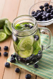 Fresh fruit Flavored infused water mix of cucumber and blueberry Stock Photo