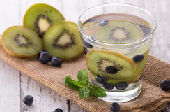 Fresh fruit Flavored infused water mix of Kiwi and bluberry Stock Photo