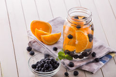 Fresh fruit Flavored infused water mix of orange, blueberry and Royalty Free Stock Image