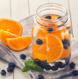 Fresh fruit Flavored infused water mix of orange, blueberry and Royalty Free Stock Photos