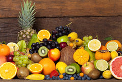Fresh fruit in front of wooden wall royalty free stock photo