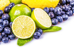 Fresh fruit. S.Sliced green lime,blueberiies.mint leave and yellow leamon Royalty Free Stock Photo