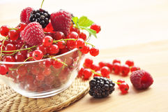 Fresh fruit in a glass bowl. On a straw mat Stock Photo