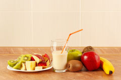 Fresh fruit and a glass of milk shake on kitchen table Royalty Free Stock Photography