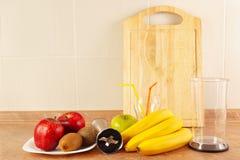 Fresh fruit, glasses and blender to prepare dessert fresh Royalty Free Stock Images
