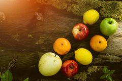 Fresh Fruits, Various Fruits, Healthy Food, Wooden Table, Bokeh Background. Fresh Fruit is Good Food for Human Life, They are giving us some nutrition for our Stock Photo