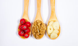 Fresh fruit of hawthorn, garlic and walnuts. The concept of alternative medicine. Stock Photo
