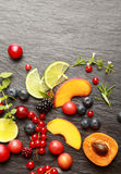 Fresh fruit and herbs on a slate background Royalty Free Stock Images