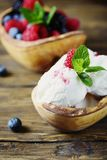 Fresh fruit ice cream with mint on the wooden background. Selective focus Stock Images