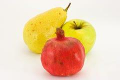 Fresh fruit isolated on white. Fresh fruit: apple, pear, garnet isolated on white background Stock Photography