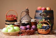 Fresh fruit, jam and wooden barrel Stock Image