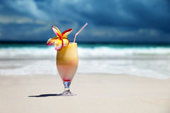 Fresh fruit juice on a beach Royalty Free Stock Photo