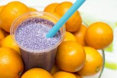 Fresh fruit juice. Fresh drink of fruit juice surrounded by ripe oranges royalty free stock image