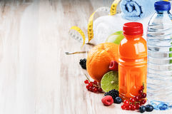 Fresh fruit juice and fitness accessories Stock Images