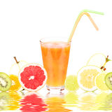 Fresh fruit juice in a glass and ripe fruits. Royalty Free Stock Photos