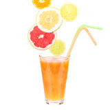 Fresh fruit juice in a glass and ripe fruits. Stock Photos