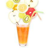 Fresh fruit juice in a glass and ripe fruits. Isolated on white background. Close-up Stock Photo