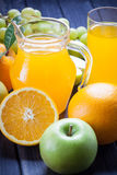 Fresh fruit and juice in the jug on wood table still life Stock Images