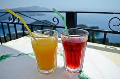 Fresh fruit juice in a restaurant in the top of Paleokastritsa. Refreshing juices in a restaurant with beautiful view in Paleokastritsa, Corfu - Greece Royalty Free Stock Images