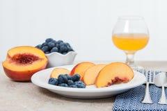 Fresh fruit with juice Royalty Free Stock Image