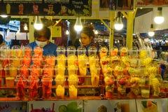 Fresh fruit juice at the street market stock image
