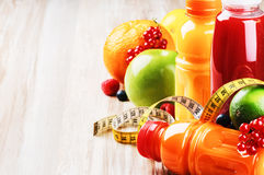 Fresh Fruit Juices In Healthy Nutrition Setting Royalty Free Stock Photography