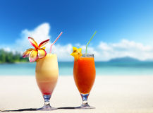 Fresh fruit juices on a tropical beach Stock Photos