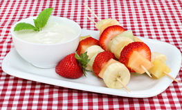 Fresh fruit kabobs and dip Royalty Free Stock Images