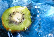 Fresh fruit, kiwi. Kiwi fruit on the water and a drop falling Stock Image